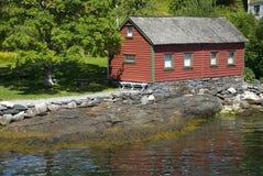 Little red norwegian hut on hardangerfjord. Norway royalty free stock photo