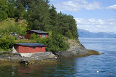 Little red norwegian huts on hardangerfjord Royalty Free Stock Photos
