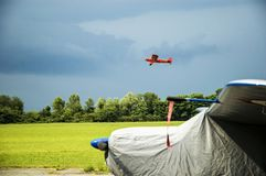 Little red plane taking off. A picture full of colors that shows a little airplane taking off during an airshow royalty free stock photos