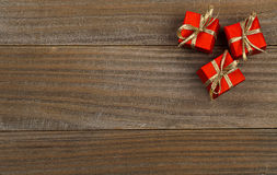 Little red presents on wood background christmas border Royalty Free Stock Photography