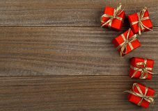 Little red presents on wood background christmas border Royalty Free Stock Photos