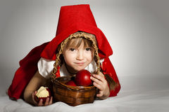 Little Red Riding Hood. Little girl wearing Little Red Riding Hood costume Vector Illustration