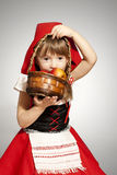 Little Red Riding Hood. A girl with a toy wolf wearing Little Red Riding Hood costume Stock Photography