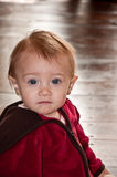 Little red riding hood. Baby girl with elf-like expression Stock Images