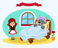 Little Red Riding Hood and the bed in which lies the wolf. Royalty Free Stock Photos