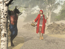 Little Red Riding Hood and the big bad wolf. Little Red Riding Hood accosted in the forest by the big bad wolf Stock Photo