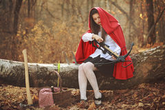 Little red riding hood with a crossbow Stock Photos