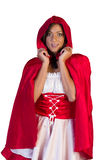 Little red riding hood holding her hood Stock Image
