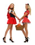 Little Red Riding Hood  and mouse. Two women in carnival costume.   Little Red Riding Hood and mouse shape. Isolated image Stock Images