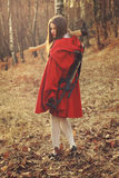 Little red riding hood posing with axe. Little red riding hood posing with her huntress weapons Royalty Free Stock Photo
