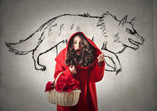 Little Red Riding Hood. Scared by the Wolf Royalty Free Stock Photography