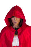 Little red riding hood standing peeping out underneath her hood Stock Photography