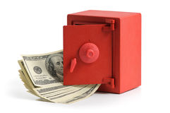 Little red safe with dollar bills Royalty Free Stock Photography