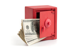 Little red safe with dollar bills Royalty Free Stock Image