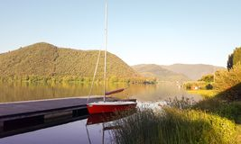 Little red sailboat at lago di Piediluco Italy royalty free stock image