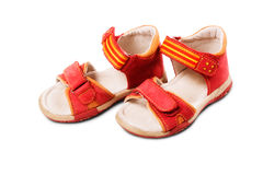 Little Red Sandals. Red baby sandals isolated on white background Royalty Free Stock Photo