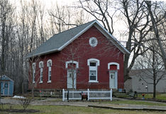 Little red schoolhouse style home. Image of a little red schoolhouse style home Royalty Free Stock Images