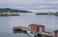 Little red shed & boat on a dock in Twillingate. royalty free stock photo