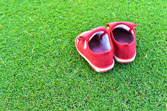 Little red shoes. On grass Stock Photography