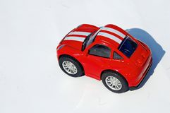 Little red toy car. Photography of little red toy car with white stripes isolated on white background stock photo