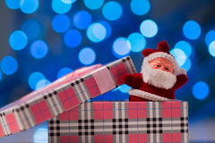 Little red toy Santa Claus in open pink gift box Royalty Free Stock Photos
