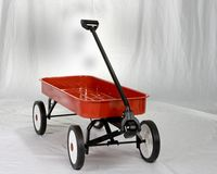 The little red wagon. A little red wagon on a white background Royalty Free Stock Image