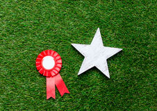 Little red winner award and star gift Royalty Free Stock Photography