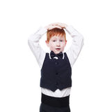 Little redhead boy in vest, surprised isolated on white Royalty Free Stock Photo