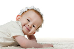 Little redhead girl is resting on the carpet Royalty Free Stock Photo