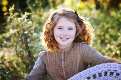 Little redhead outdoors Stock Photos