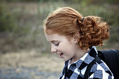 Little redhead with pigtails Royalty Free Stock Image