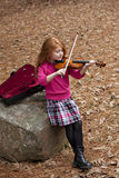 Little Redhead playing violen Royalty Free Stock Photo