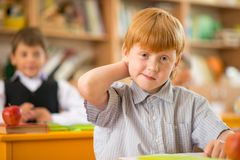 Little redhead schoolboy stock image