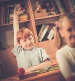 Little redhead schoolboy during lesson Royalty Free Stock Image