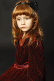 Little redheaded girl. On  a black background Royalty Free Stock Photo