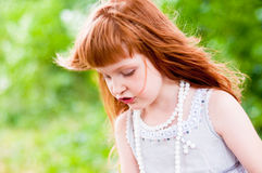 Little redheaded girl. On the nature Royalty Free Stock Photos