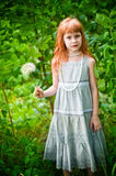 Little redheaded girl. On the nature Royalty Free Stock Photography
