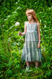 Little redheaded girl. On the nature Royalty Free Stock Image