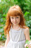 Little redheaded girl. On the nature Royalty Free Stock Images