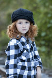 Little redheaded girl outdoors Stock Photos