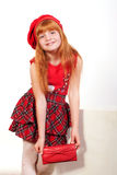 Little redheaded girl in red. Little redheaded girl on a white background Royalty Free Stock Photo