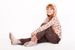 Little redheaded girl. On a white background Royalty Free Stock Photography