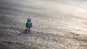 Little retro tin robot walking down road Royalty Free Stock Images
