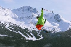 Little Ripper 2. A talented 10 year old skier does huge tricks in a freestyle ski jump park Stock Photos