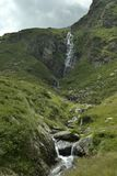 Tiny waterfall. Little river fall from the very green mountains colors from Scotland, Ireland, north Europe stock image