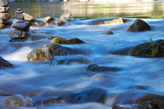 Little river with many stones. And rocks Stock Photography