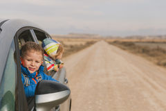 Little rland g travel by car on the road Stock Photos