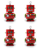 Little robot. Little vintage toy robot with four different facial expressions over white background Stock Images