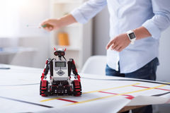 Little robot getting ready to work Royalty Free Stock Photos