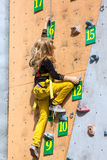 Little rock climber on climbing wall Stock Photography